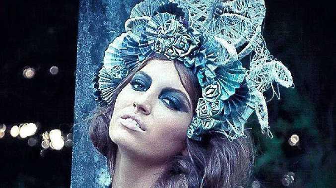 Model Cacharel Caswell wears Hannah Graham's winning headpiece.