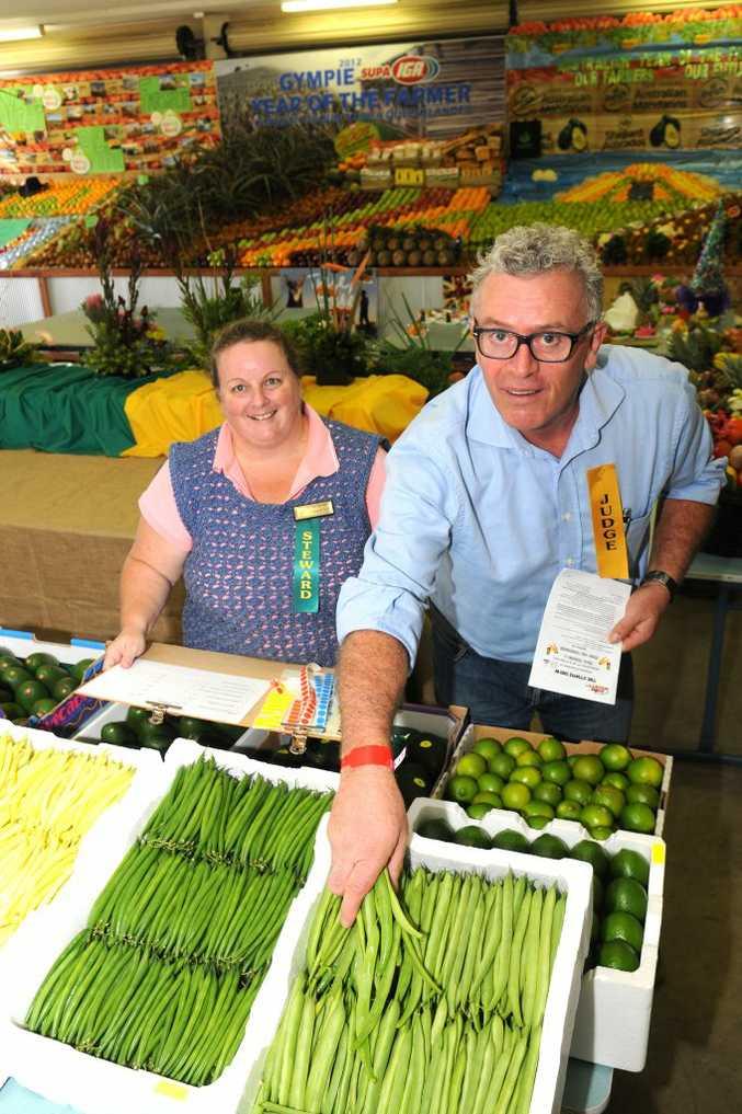 Steward Marianne Wyllie helps judge Stephen Wirtz select the best beans at the Gympie Show.