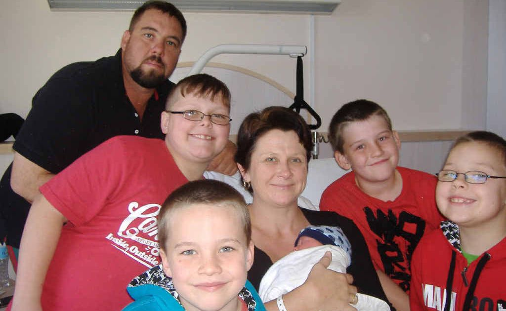 Dana Schneider holds new arrival Toby this week. Father Jason is at the back while brothers Jack, Ben, Bailey and Lachie all smile for the camera.