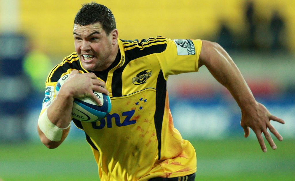 Ben May of the Hurricanes runs the ball during the round 13 Super Rugby match between the Hurricanes and the Brumbies at Westpac Stadium