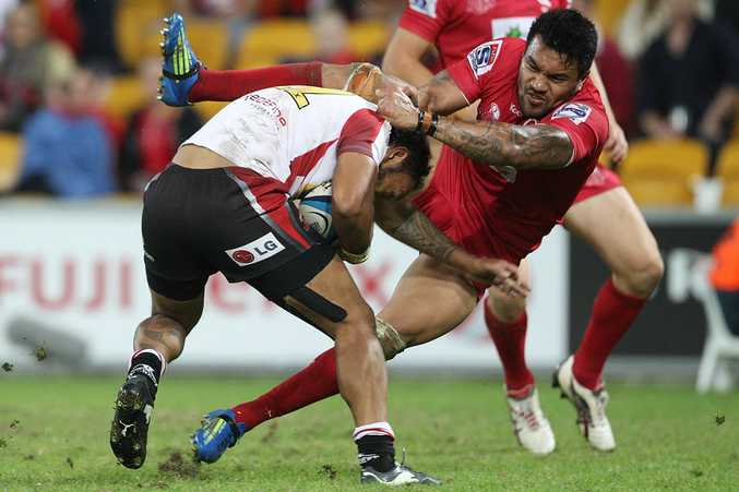 James Kamana of the Lions is tackled by Digby Ioane of the Reds during the round 13 Super Rugby match between the Reds and the Lions at Suncorp Stadium.