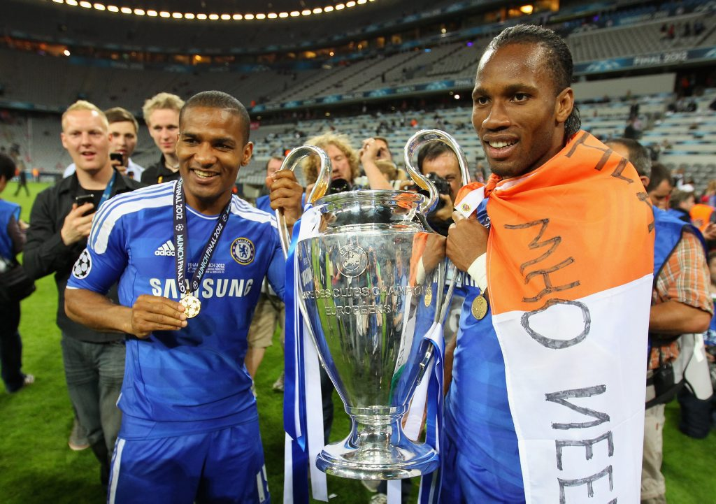 Didier Drogba (right) and Florent Malouda of Chelsea celebrate with the trophy after their victory in the UEFA Champions League Final between FC Bayern Muenchen and Chelsea at the Fussball Arena Munchen on May 19, 2012 in Munich, Germany.