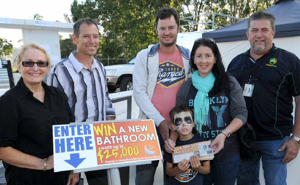 Daily Mercury newspaper sales manager Sheryl Gomersall (left), Beautiful Bathroom Renovations' Gavin Longshaw (second from left) and Australian Events' Bob Carroll (right) congratulate Dale, Owen and Joy Riordon.