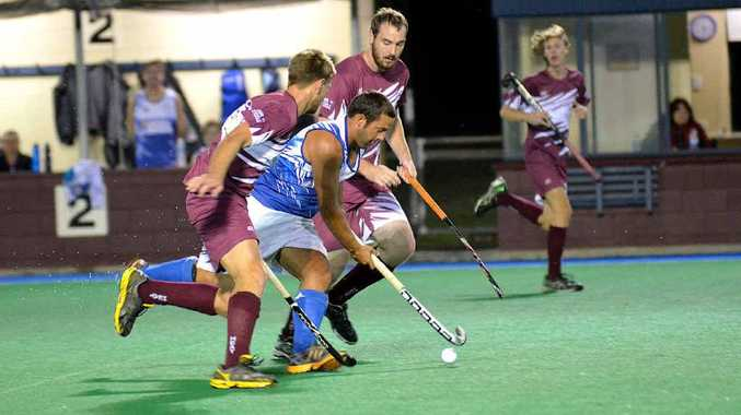 Bundaberg Cities' Brodie Latham carries the ball forward while the Cooloola Heat's Dom Stephens and Lachlan Robertson chase hard. Latham was the match winner for Cities.