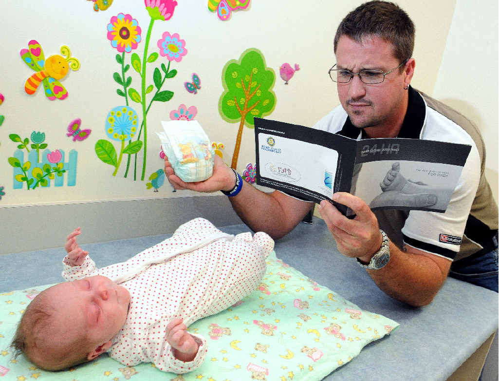 New dad Shannon Mott learns everything he needs to know about caring for his daughter Kimberlee Mott.