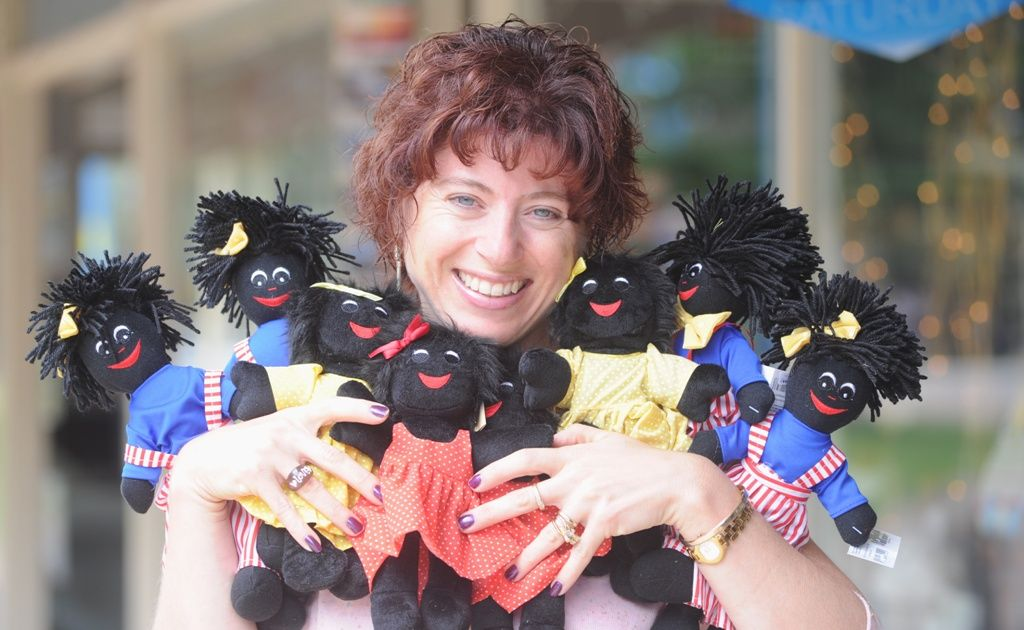 Deanne Edwards with the golliwogs she sells at her Prestige Flowers and Gifts store on the Esplanade at Urangan.