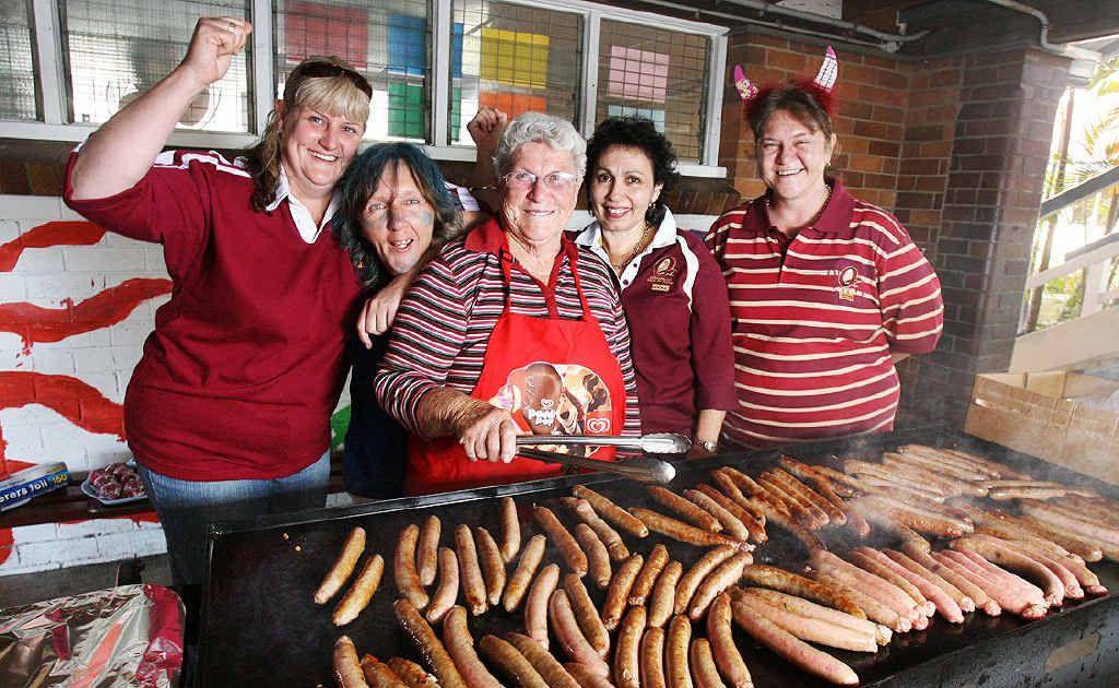The Tuckshop ladies at Blair State School got into the spirit of State of Origin with Allan Langer's mum, Rita Langer.