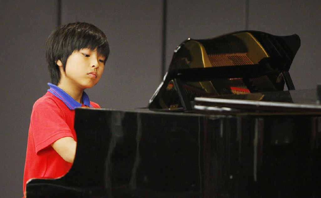 Winner of the nine years piano solo section, Kai Hagiwara, gives it his all in the Ipswich Eisteddfod yesterday.
