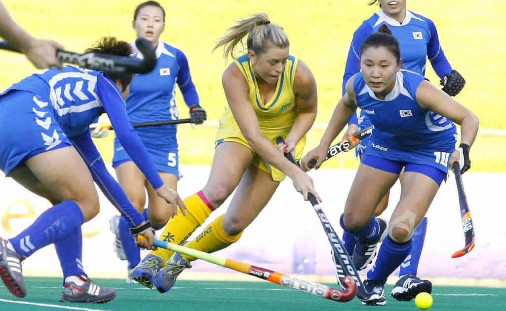 Ipswich's Olympic hopeful Jordyn Holzberger challenges strongly for the ball while representing Australia against Korea earlier this year.
