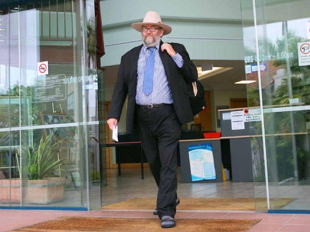 Peace activist Bryan Law leaves the Rockhampton Courthouse.