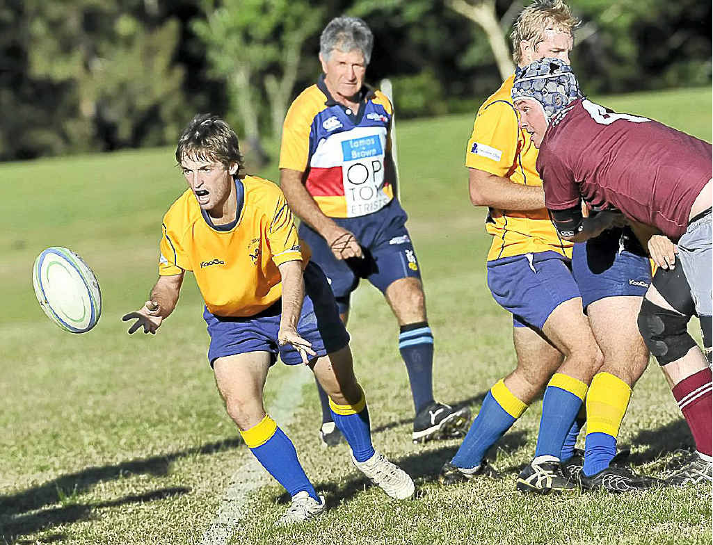Southern Cross University scrum half Sam McPherson clears the ball from a ruck during the game against Casino at Maurie Ryan Oval in Lismore last Saturday. The Casino Bulls won 20-17 with a drop goal right on full-time. The referee is Mick Melino.