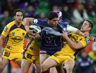 Jesse Bromwich of the Storm is tackled during the round 12 NRL match between the Melbourne Storm and the Brisbane Broncos at AAMI Park