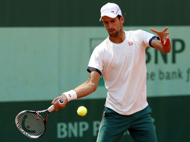 Novak Djokovic of Serbia plays a backhand during a practice session on day one of the French Open at Roland Garros on May 27, 2012 in Paris, France.