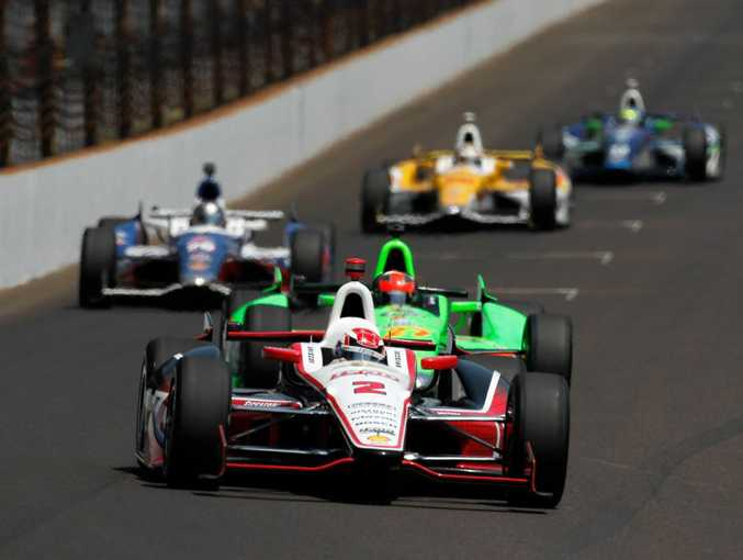 Ryan Briscoe, driver of the #2 IZOD Team Penske Chevrolet, leads a pack of cars into turn one during the IZOD IndyCar Series 96th running of the Indianpolis 500 mile race at the Indianapolis Motor Speedway on May 27, 2012.