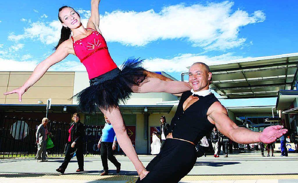 Gymnasts Skye Haddy and Shane Elisara help celebrate Riverlink Shopping Centre's fifth birthday on Saturday.
