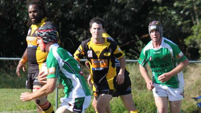Ryan Gill takes the ball up for the Stags in a brutal match against Caboolture.