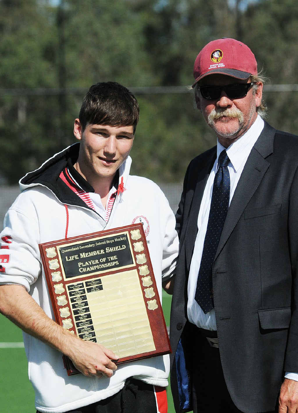 Gympie's Drew Wenzel was named Player of the Championship at the Queensland hockey titles. He is pictured with manager Peter Chatman.