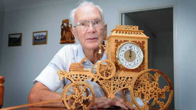 Bill Mason with his cottage clock, not quite as intricate as some of his work, but still a week's solid work to carve.