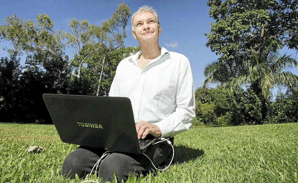 Dr John Abbot from CQUniversity examines the weather patterns on his laptop program that predicts conditions up to nine months in advance.