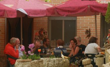 Pilgrims staying at the Boadilla del Camino albergue share a mid-afternoon drink.