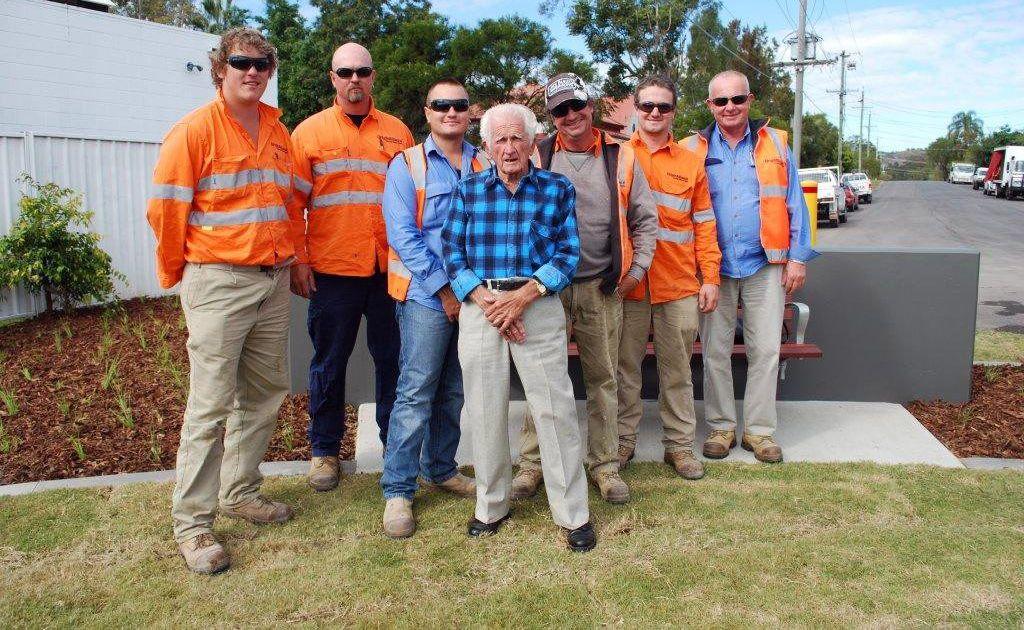 Bertie Randorf stands with the Origin Alliance workman he visited each day as the Ipswich Motorway was constructed.