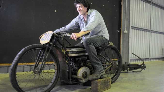 Tor Macdonald tries out the 1924 Douglas, Isle of Man racer. Photo Bev Lacey.