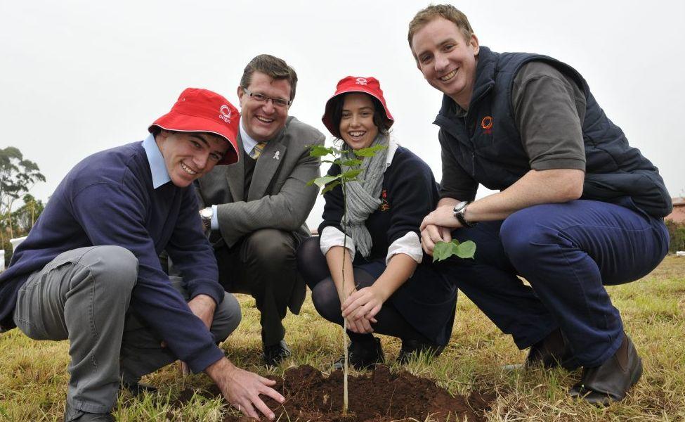 Matt Fing, Trevor Watts, Emily Brassington and Scott Bird plant some pongonia trees at Toowoomba State High School Wilstonton campus.