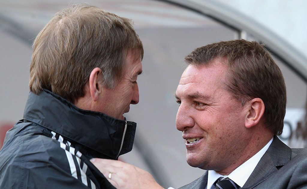 Kenny Dalglish (back) and Brendan Rodgers shake hands before the start of the Liverpool versus Swansea match. Rodgers has replaced Dalglish as the manager of the Anfield club.