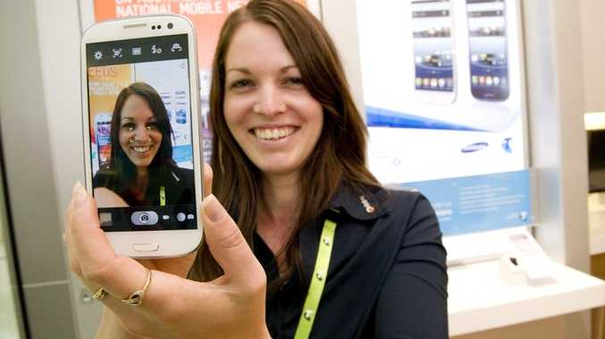 Toowoomba Telstra store tech expert Alicia Hannah tries out the new Samsung Galaxy S3. Photo Kevin Farmer.