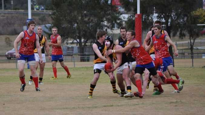 STRUGGLE: Tigers Michael Bailey and Aaron Gatfield defend team mate Luke Adams (holding ball) from Redbacks Tyhe Clarkson and Shawn Brown.