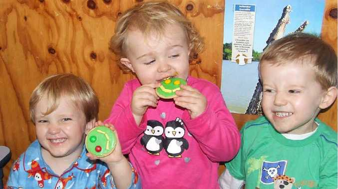 Elliott Nolan, Dean Sandy, Claire Moylan and Nicholas Knox enjoying a smiley biscuit.