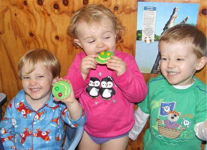 Elliott Nolan, Dean Sandy, Claire Moylan and Nicholas Knox enjoying a smiley biscuit.