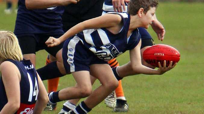 Kade Kent in action in the under-14 Gympie Cats side.