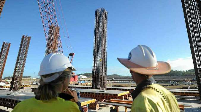 Workers look out over the Curtis Island project.