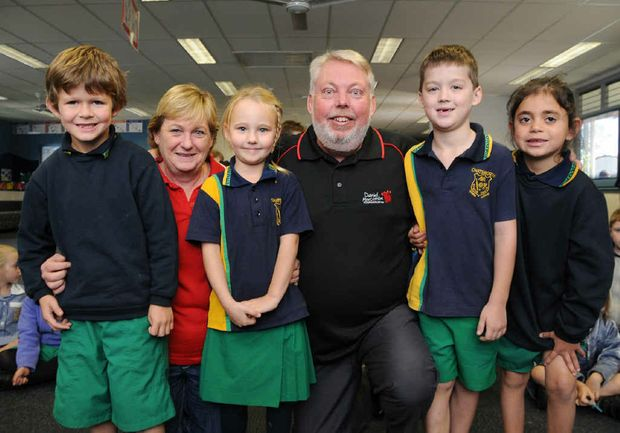 Denise and Bruce Morcombe with Chatsworth Primary School students Hayden Cook, Selina Walser, Hayden Hanslow and Elsie Gawn and Mr Morcombe with his new tattoo in memory of Daniel (inset).