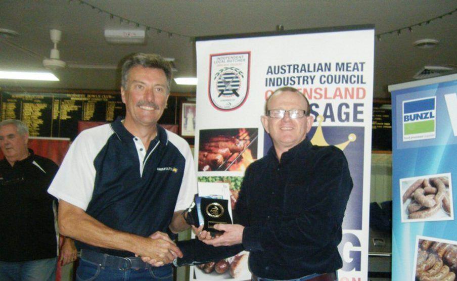 BEST LAMB AND PORK SAUSAGES: David Ashton AMIST Superannuation Fund presents the Australian Lamb Open Class trophy to Tim Duggan of Munduberra Butchering Co.