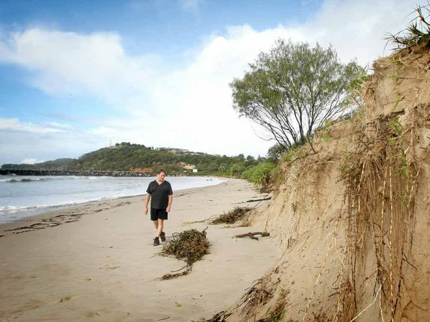 Erosion at Evans Head Surf Club, local Garry Cribb inspects the damage.