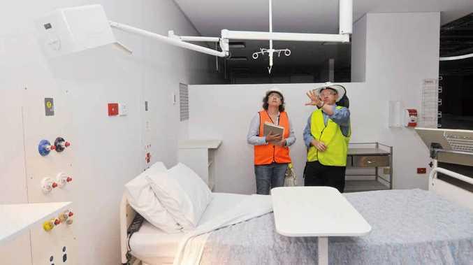 Mackay Queensland Health public affairs manager Danielle Jesser and redevelopment team co-ordinator Glenn Hokin inspect the new adult emergency department.