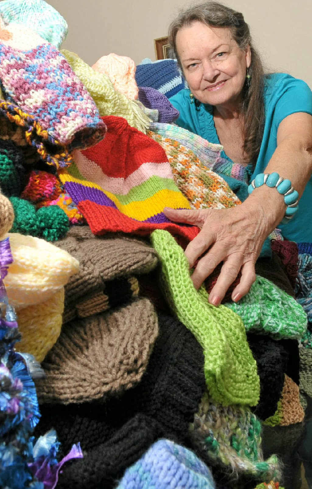 June Luton prepares to distribute items lovingly knitted by the Winter Angels.