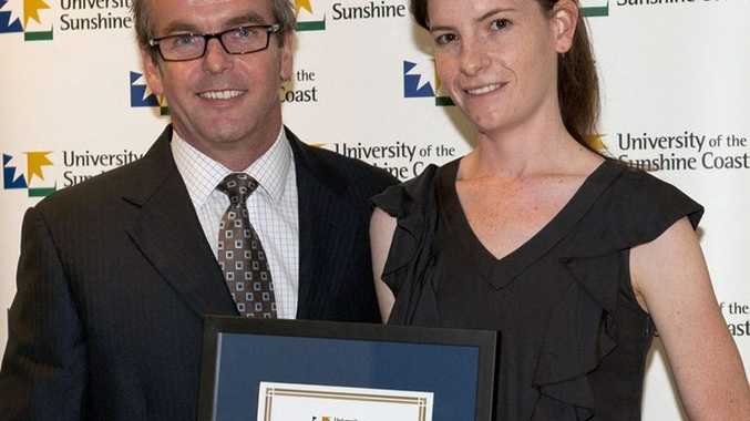 Former Toowoomba woman Amy Reardon receives an academic award from Brendan Bathersby at the University of Sunshine Coast School of Business Awards.