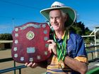 Blind Bowler Wayne Thomson with the shield and medals he won at the Australian Blind Bowls Championships earlier this year