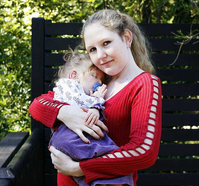 Christine Priestley holds her 22-month-old daughter, Adele Elliott, who suffers from a rare genetic condition.