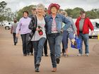 Pam Winter from Burrum Heads and Lillian Gardam from NSW kick up their heels at the Stampede at the Maryborough Showground.