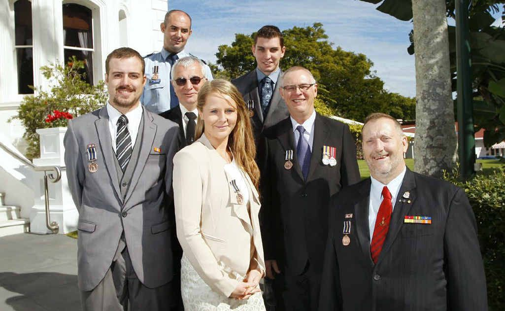 Award recipients for service in the floods in and around Ipswich (from left) Brendon Weber, Senior Constable Jon Kirkman, Andrew Shortland , Cassandra Broadfoot, Andrew Kelly, Jon Klaebe, and Jim Runham SC AFSM OAM, and (pictured left) firefighters Andrew Neil (left) and Brad Mills.