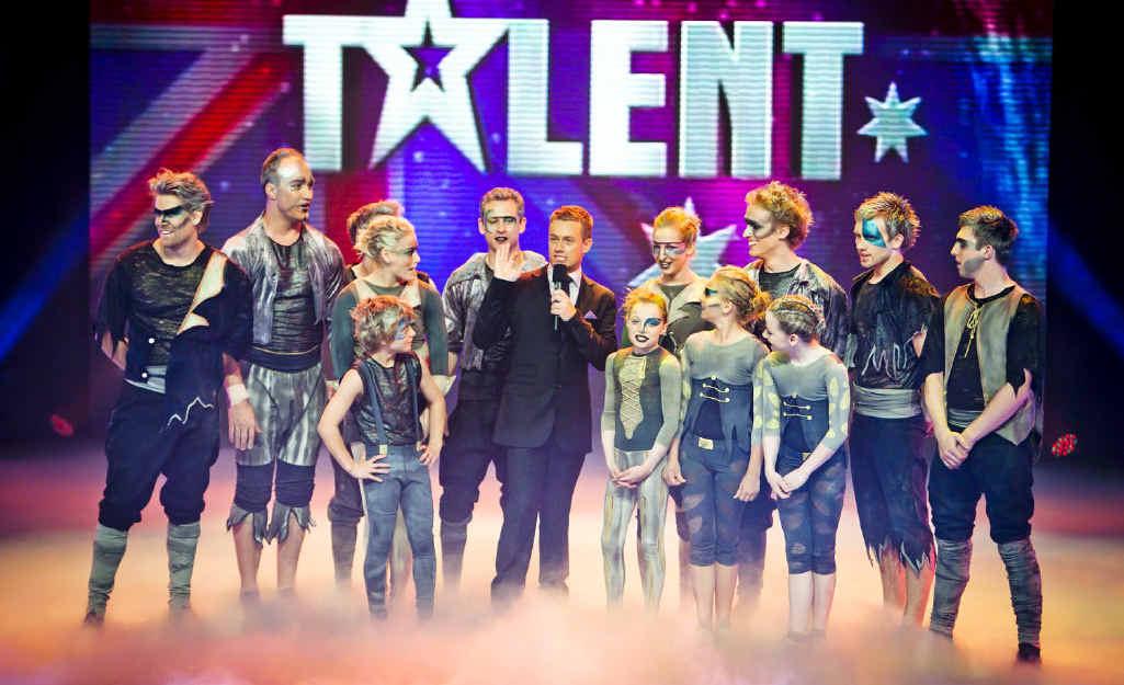 Redbank Plains State High School teacher David Hamer on stage with Odyssey in Australia's Got Talent.