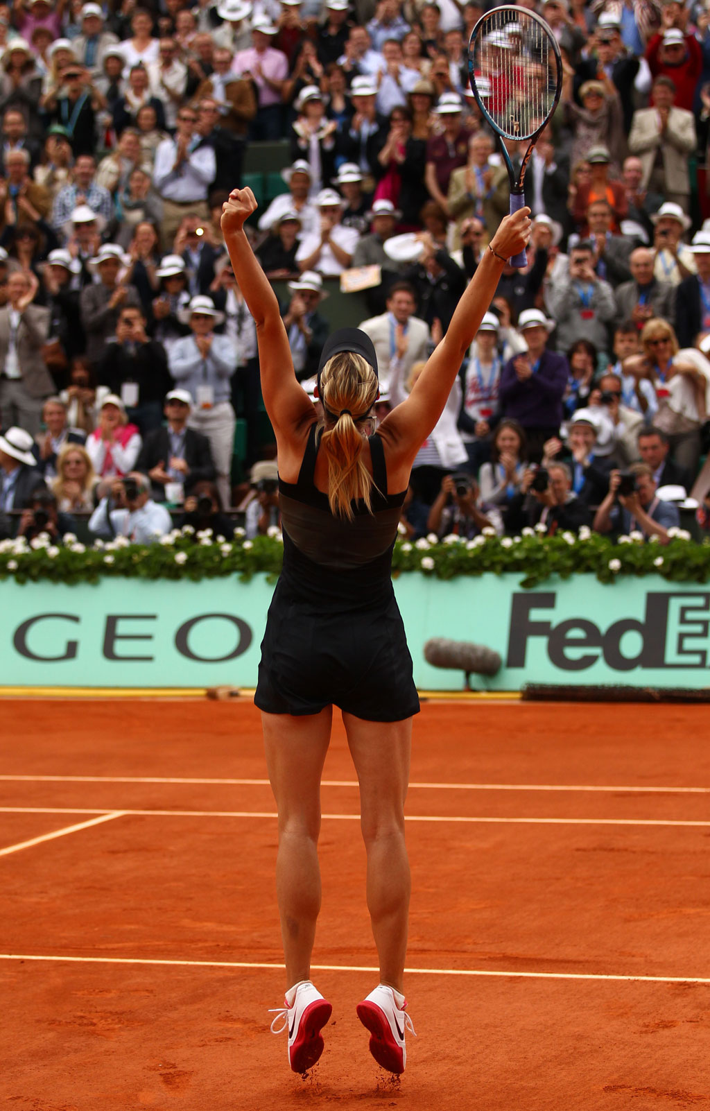 Maria Sharapova of Russia leaps in the air as she celebrates victory in the women's singles final against Sara Errani of Italy during day 14 of the French Open at Roland Garros