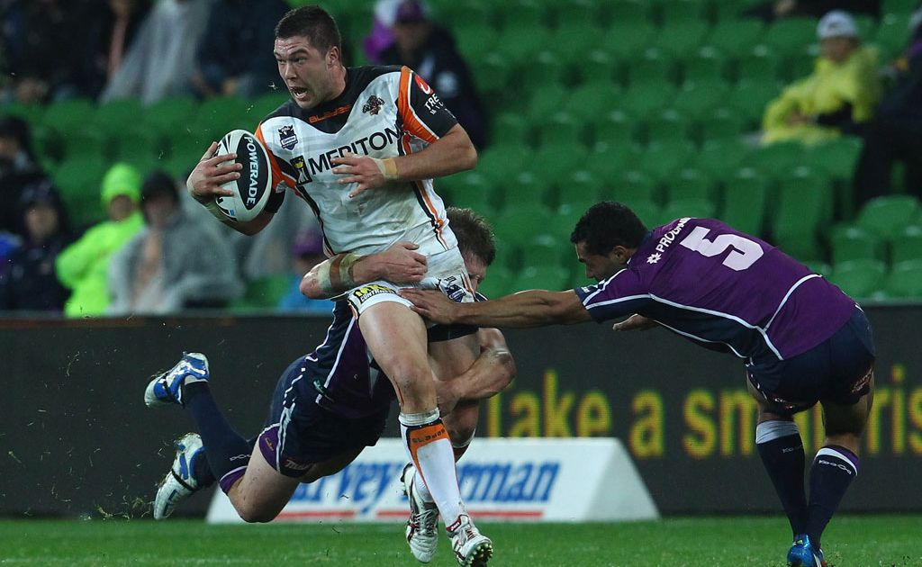 Curtis Sironen of the Tigers breaks away from his opponents during the round 14 NRL match between the Melbourne Storm and the Wests Tigers at AAMI Park