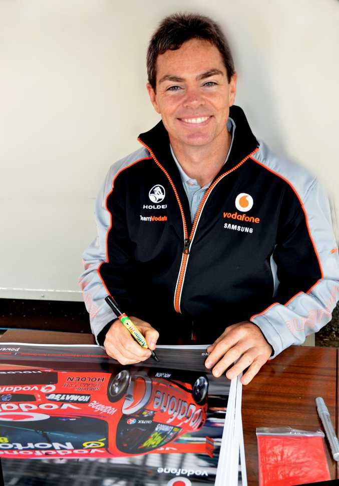 Craig Lowndes signed hundreds of posters for eager fans at the Cooyar car show.