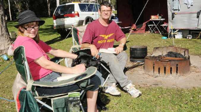 Janet Pratt and David Fuller camp on Slim Dusty Dr. The Maleny couple aren't going to the muster but are soaking up the pre-muster atmosphere in the Amamoor Creek State Forest.
