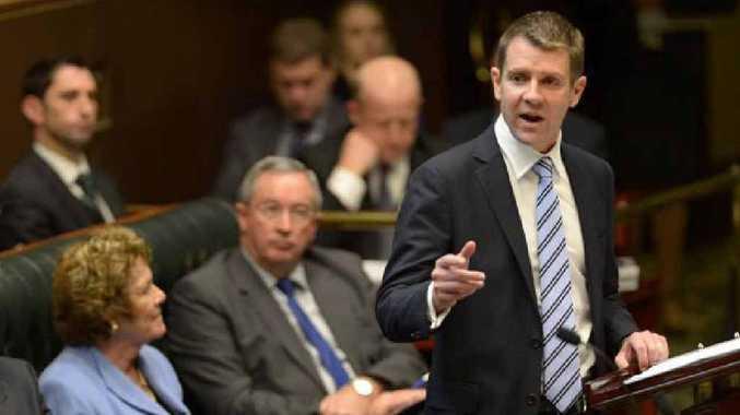 TOUGH CALL: NSW Treasurer Mike Baird delivers his tough Budget.